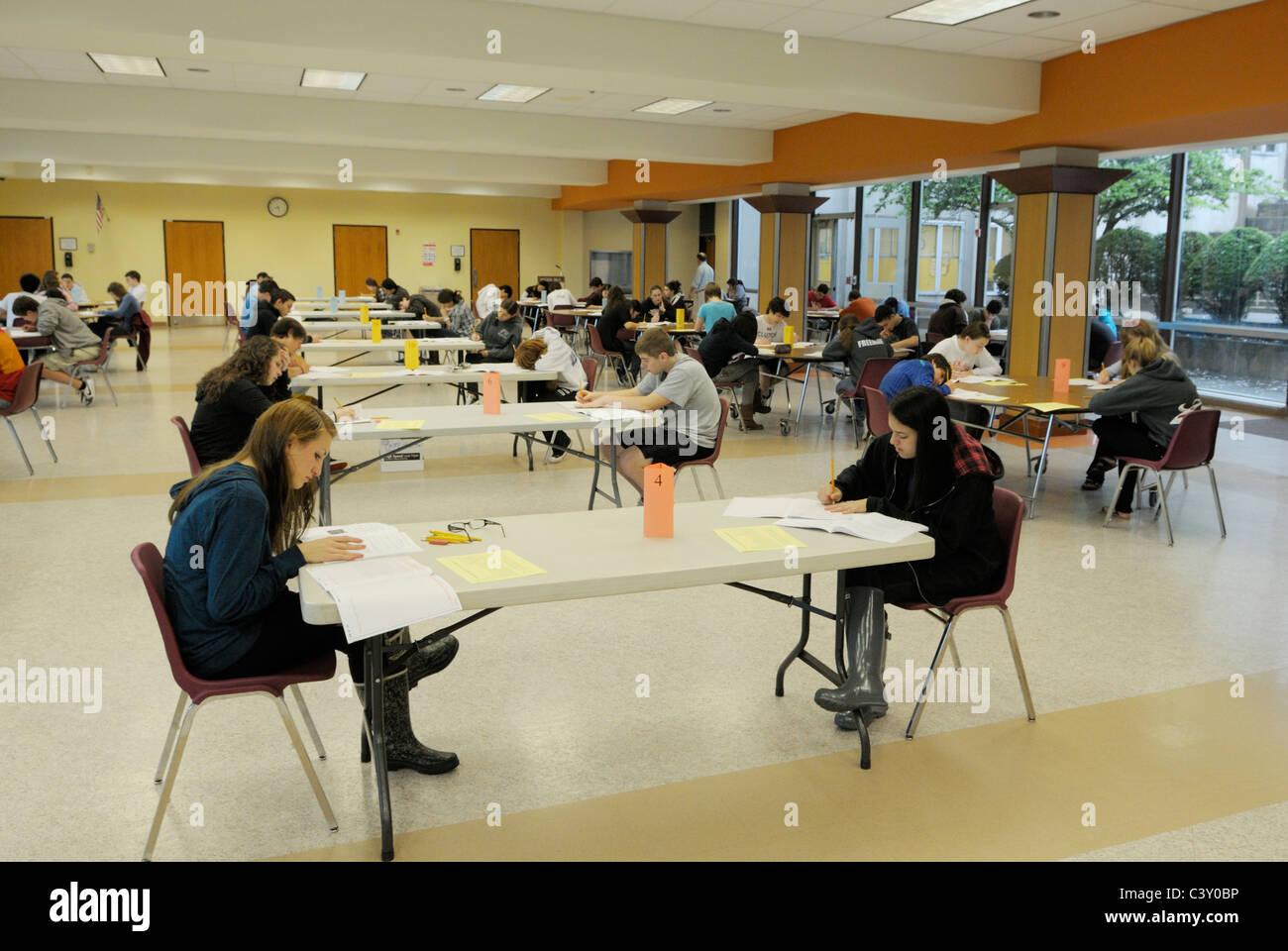 high school students taking a standardized test stock