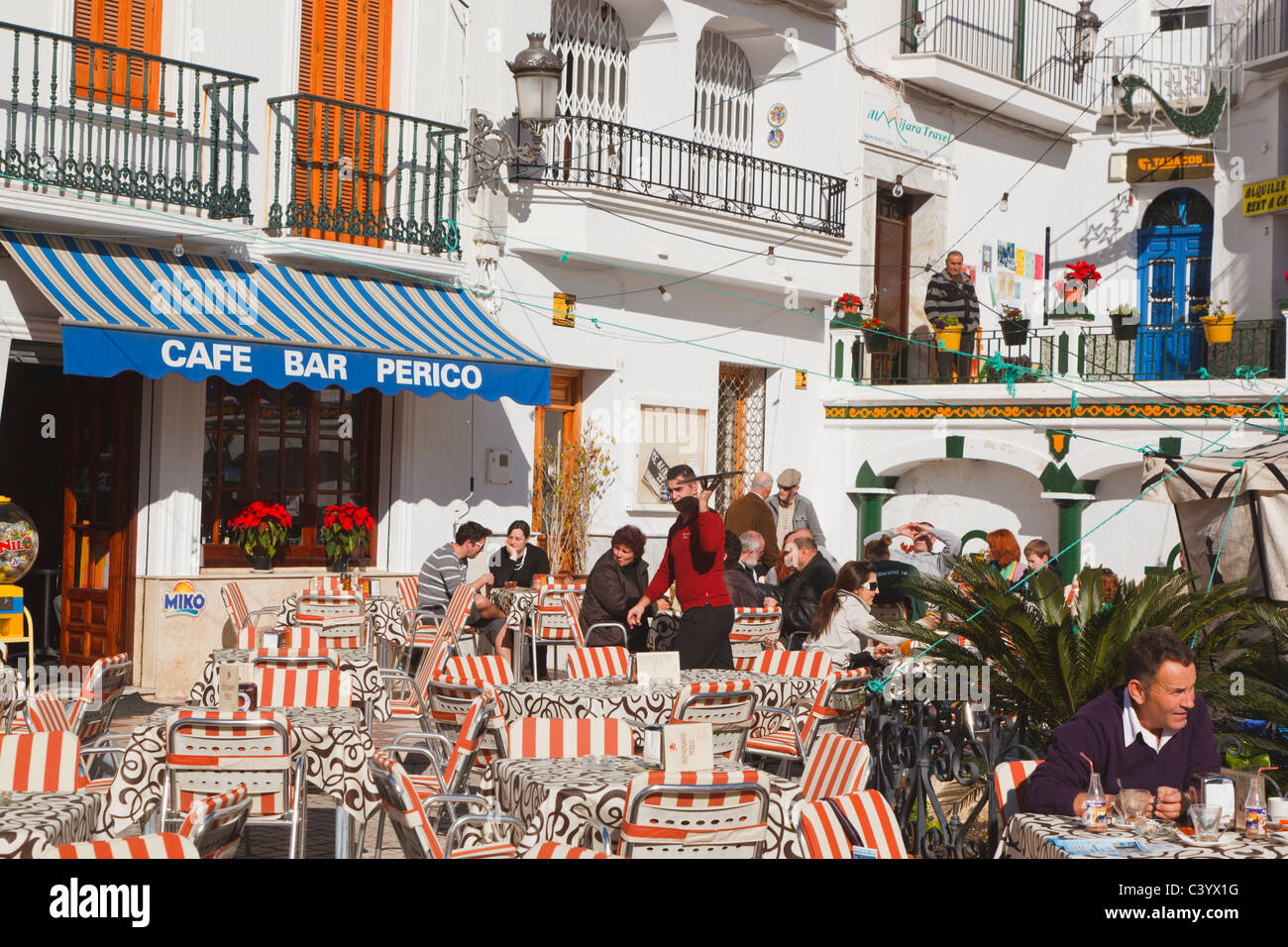 white town of competa la axarqu a malaga province spain people at stock photo royalty free. Black Bedroom Furniture Sets. Home Design Ideas