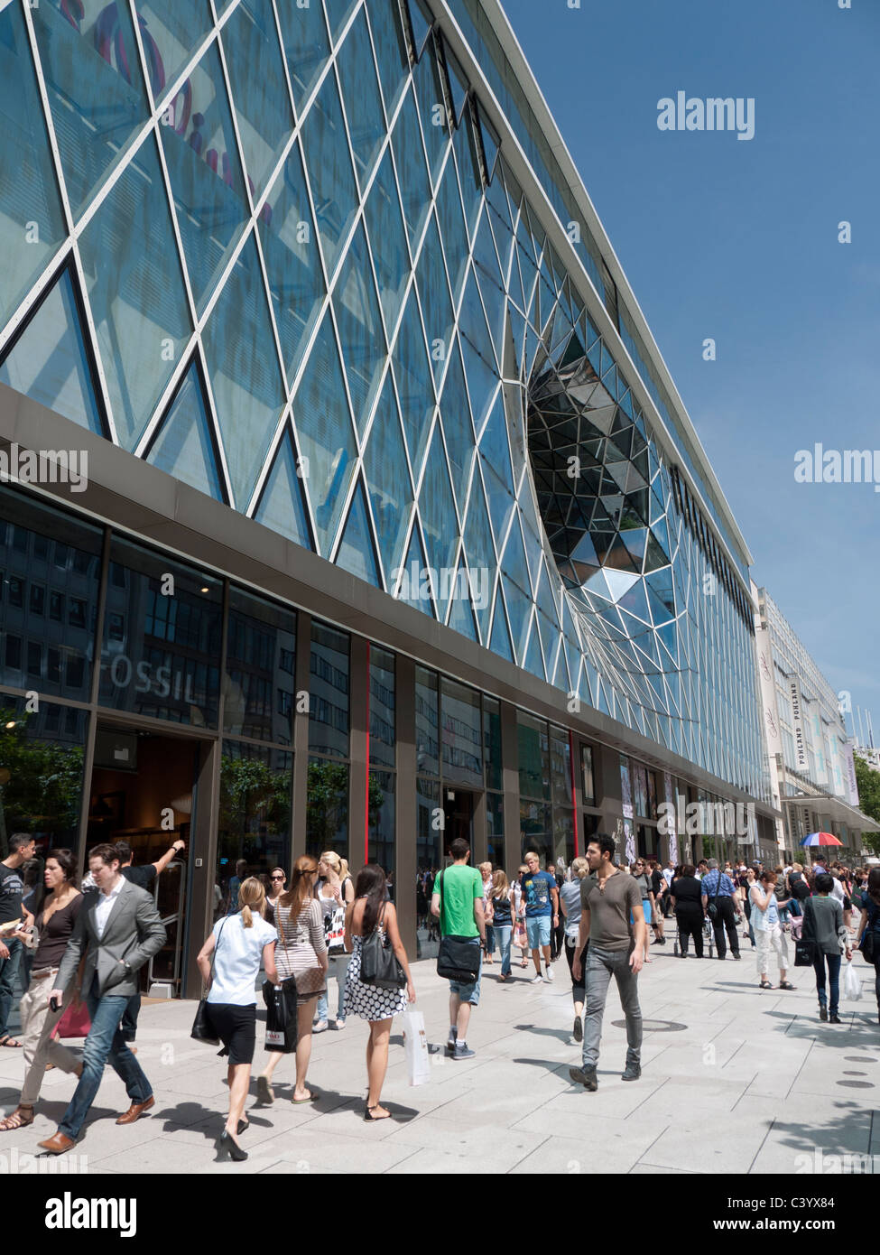 busy street outside new futuristic architecture of myzeil shopping
