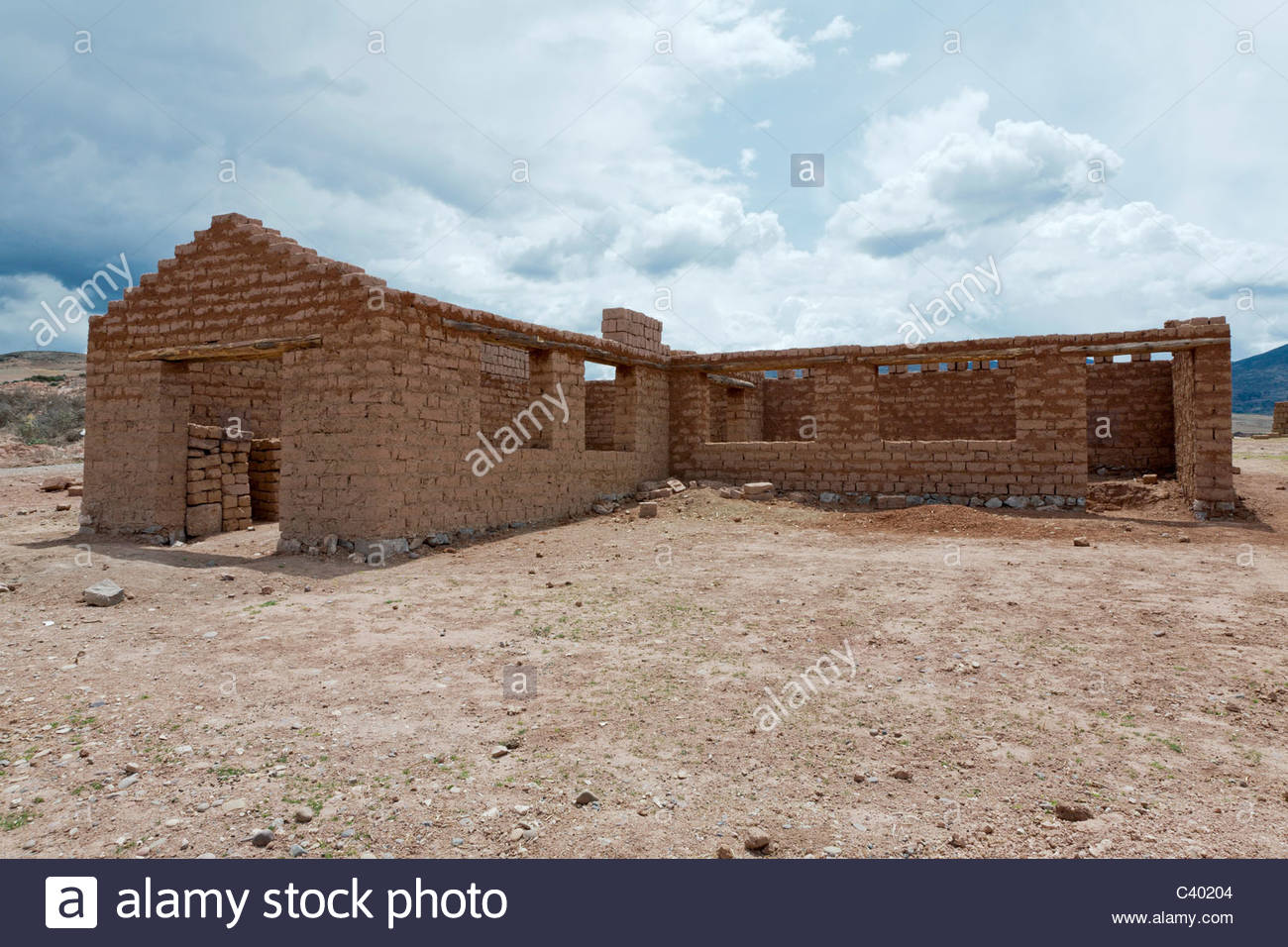 An Adobe House Being Built Using Hand Made Adobe Bricks