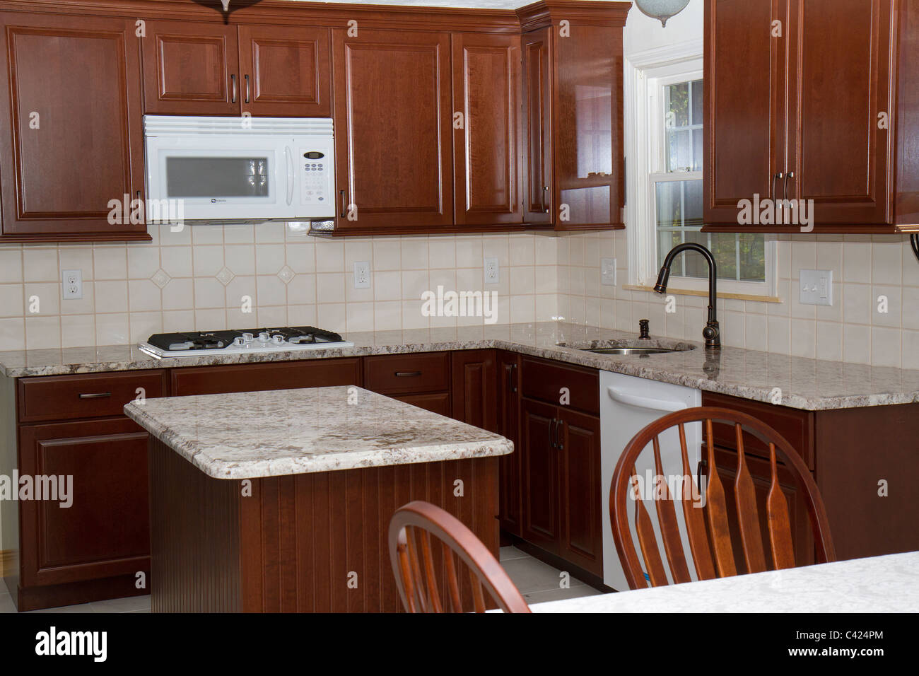 New Cherry Cabinets, Granite Counter Tops, And Ceramic Tile Floor Highlight  Kitchen Remodeling Job