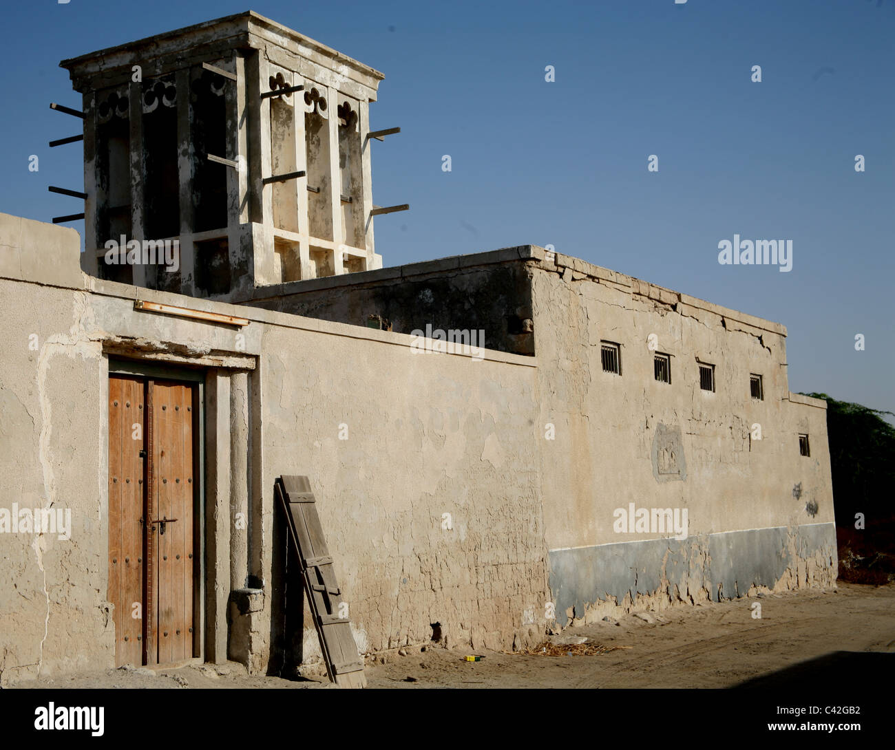 old house with wind tower in jasira quarter of ras al