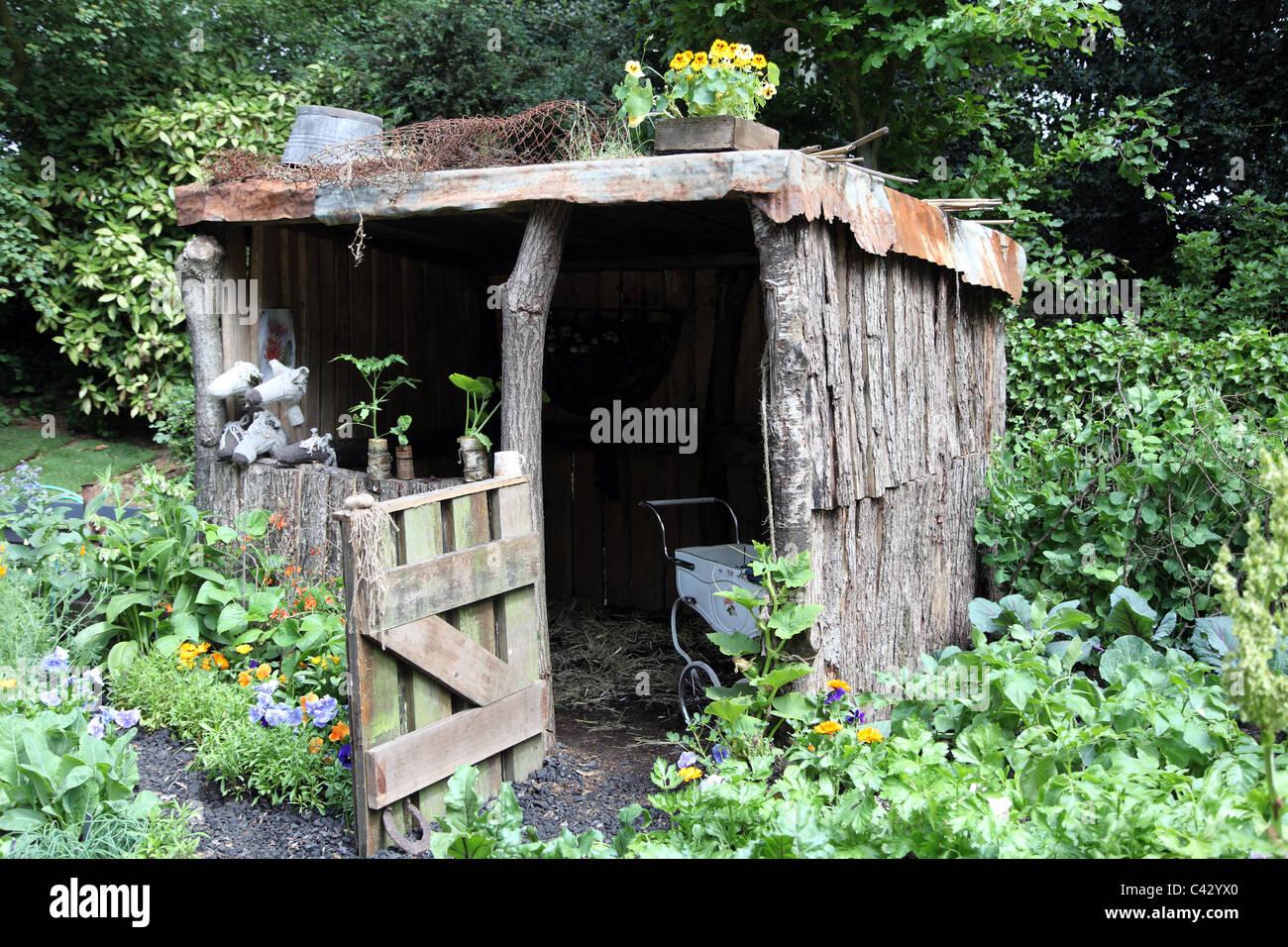 Garden shed in a child 39 s garden in wales artisan garden for Children s garden sheds