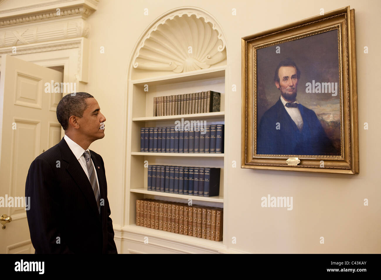 president barack obama looks at the portrait of abraham lincoln that hangs in the oval office barack obama oval office