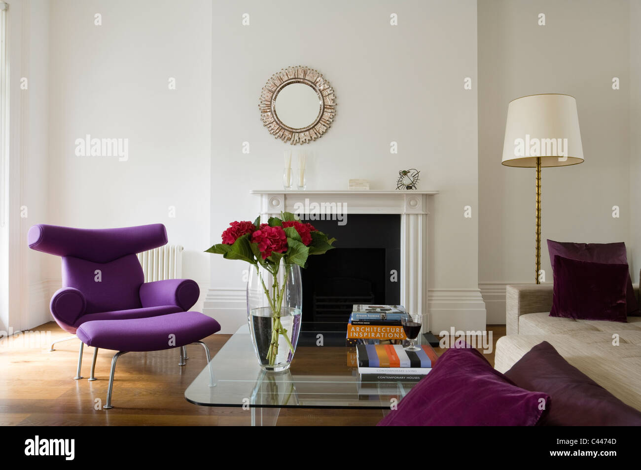 purple hans wegner ox chair with footstool in living room with line