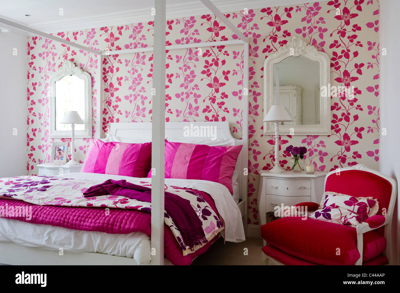 Pink Wallpaper For Bedroom Red Velvet Armchair In Bedroom With Fourposter Bed And Designers