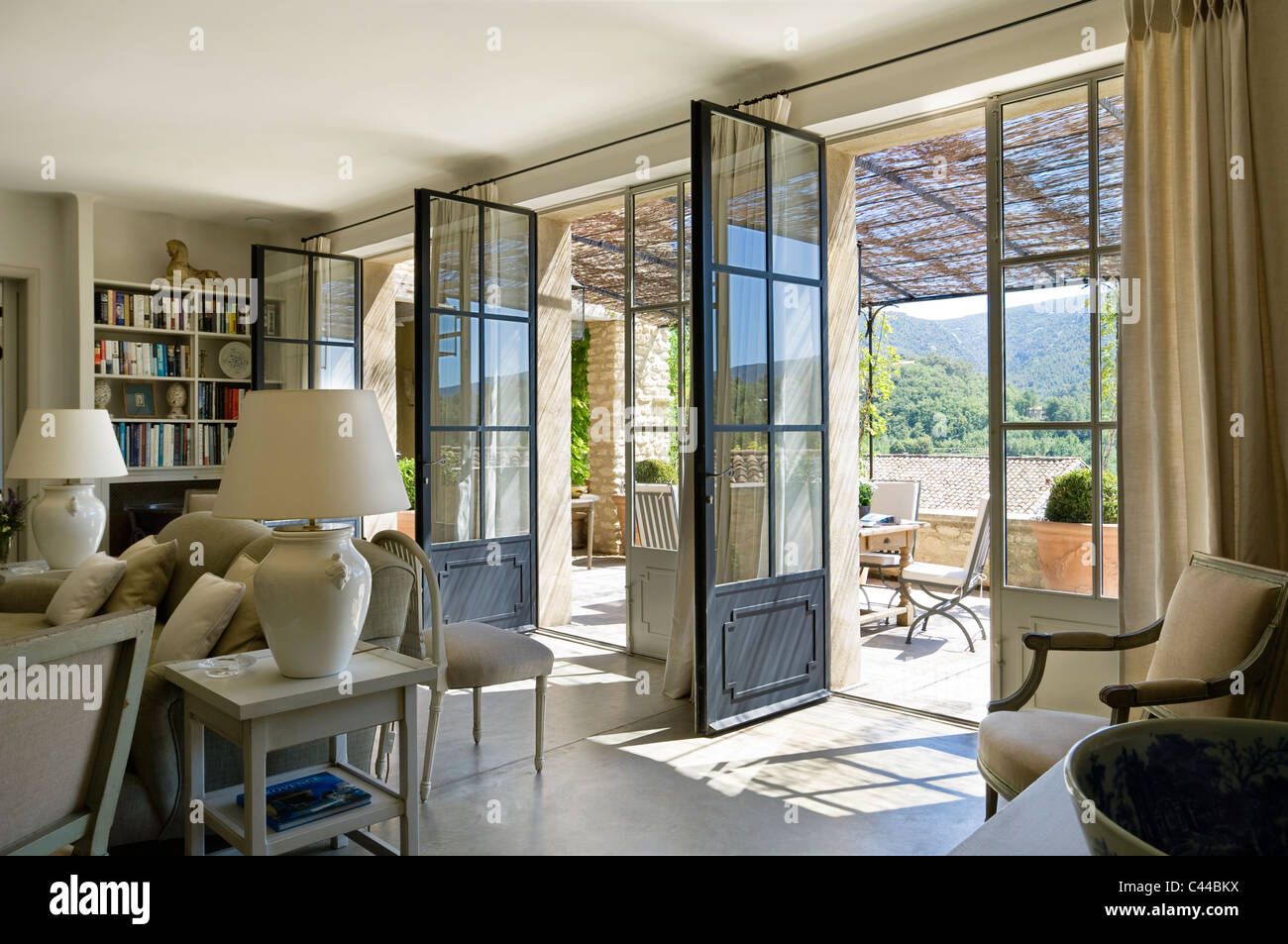 Spacious Living Room With Three Open French Windows