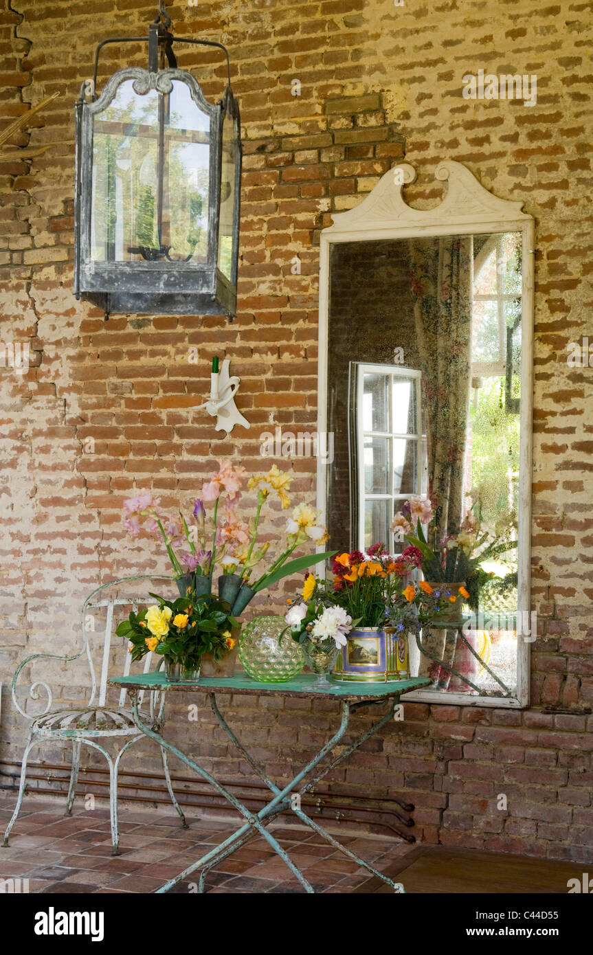 red brick furniture. Wrought Iron Garden Furniture And Large Lantern Along Red Brick Exterior Of French Country House T