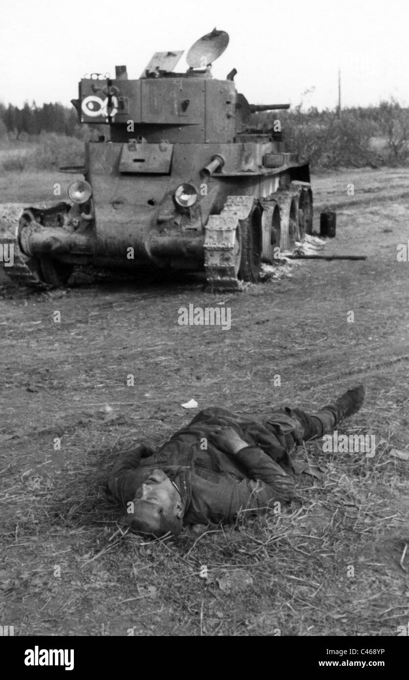 U.S. Marine walks by an unidentified charred corpse. In the ...