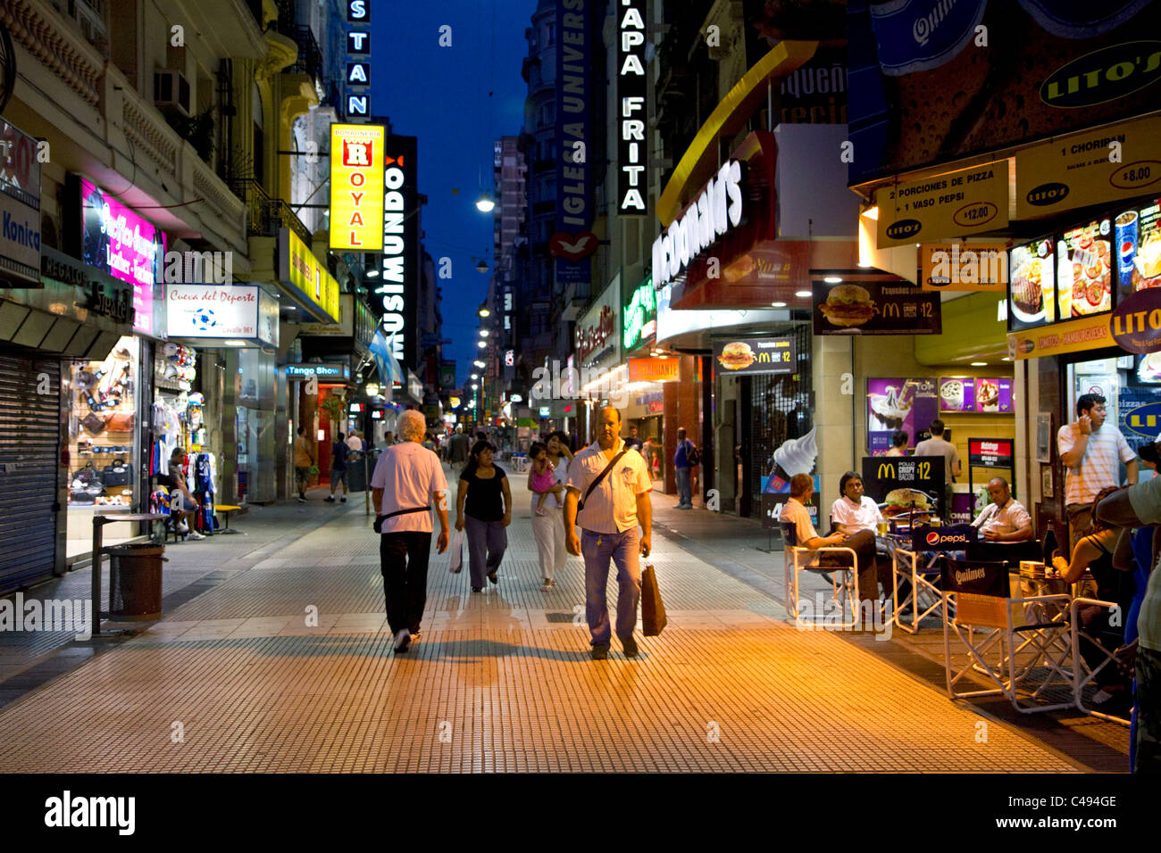 People walking on Lavalle Street at night in Buenos Aires ...