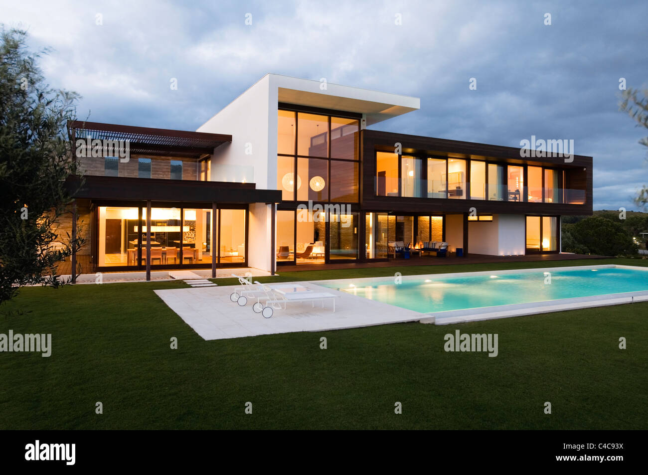 Front elevation at dusk of modern villa in spain stock for Villas elevations photo gallery