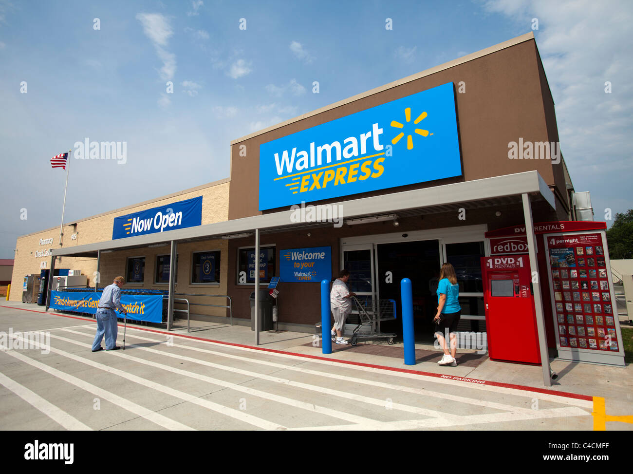 Customers enter a Walmart Express store in Gentry
