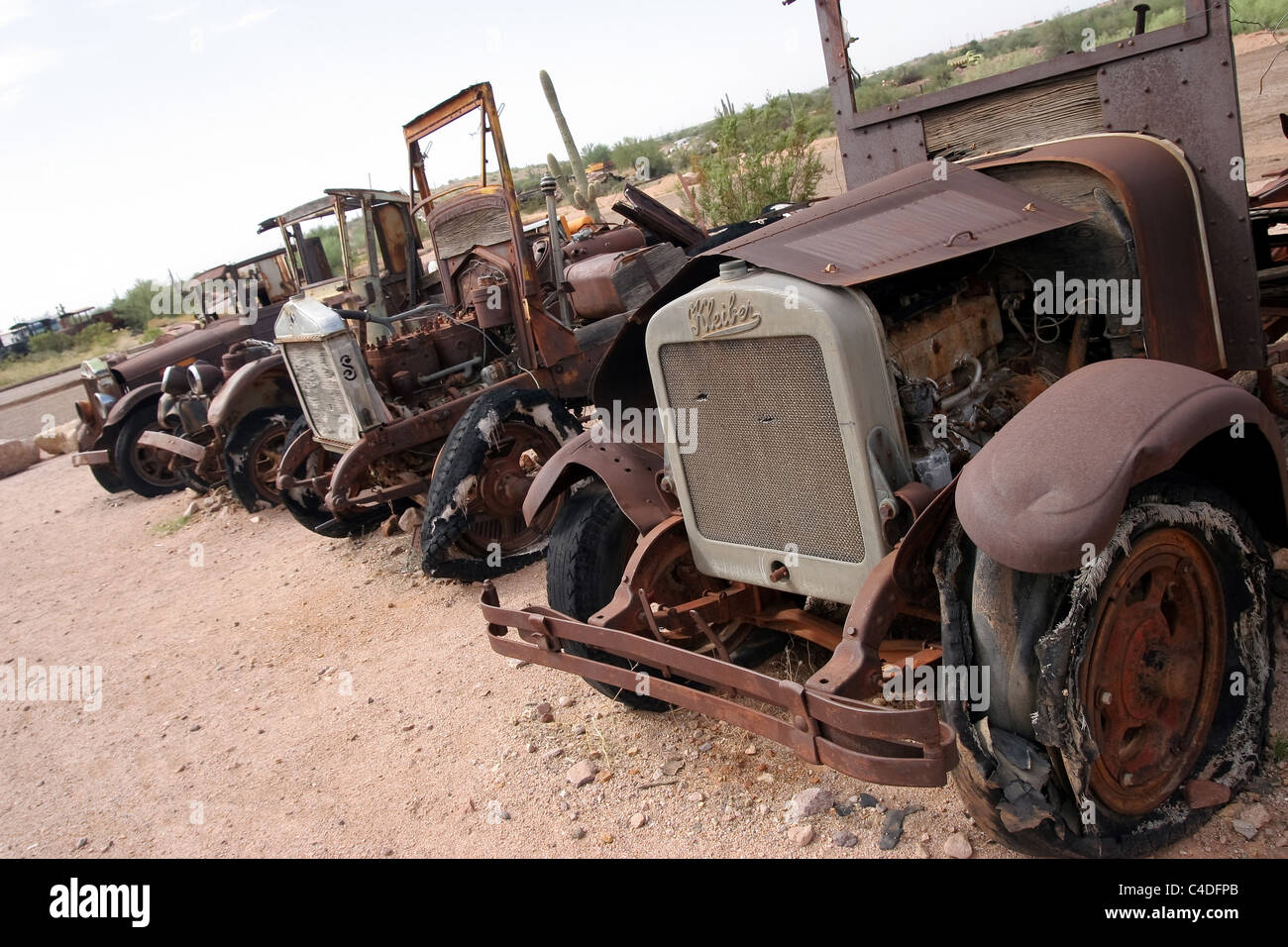 Old Vehicles cars trucks rusting away in a ghost town Arizona ...