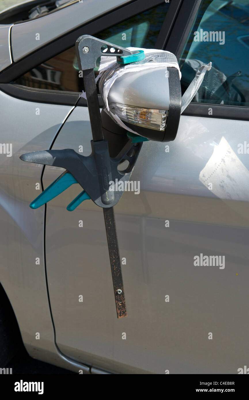 diy repair to broken car wing mirror using sticky tape and clamp stock photo royalty free image. Black Bedroom Furniture Sets. Home Design Ideas