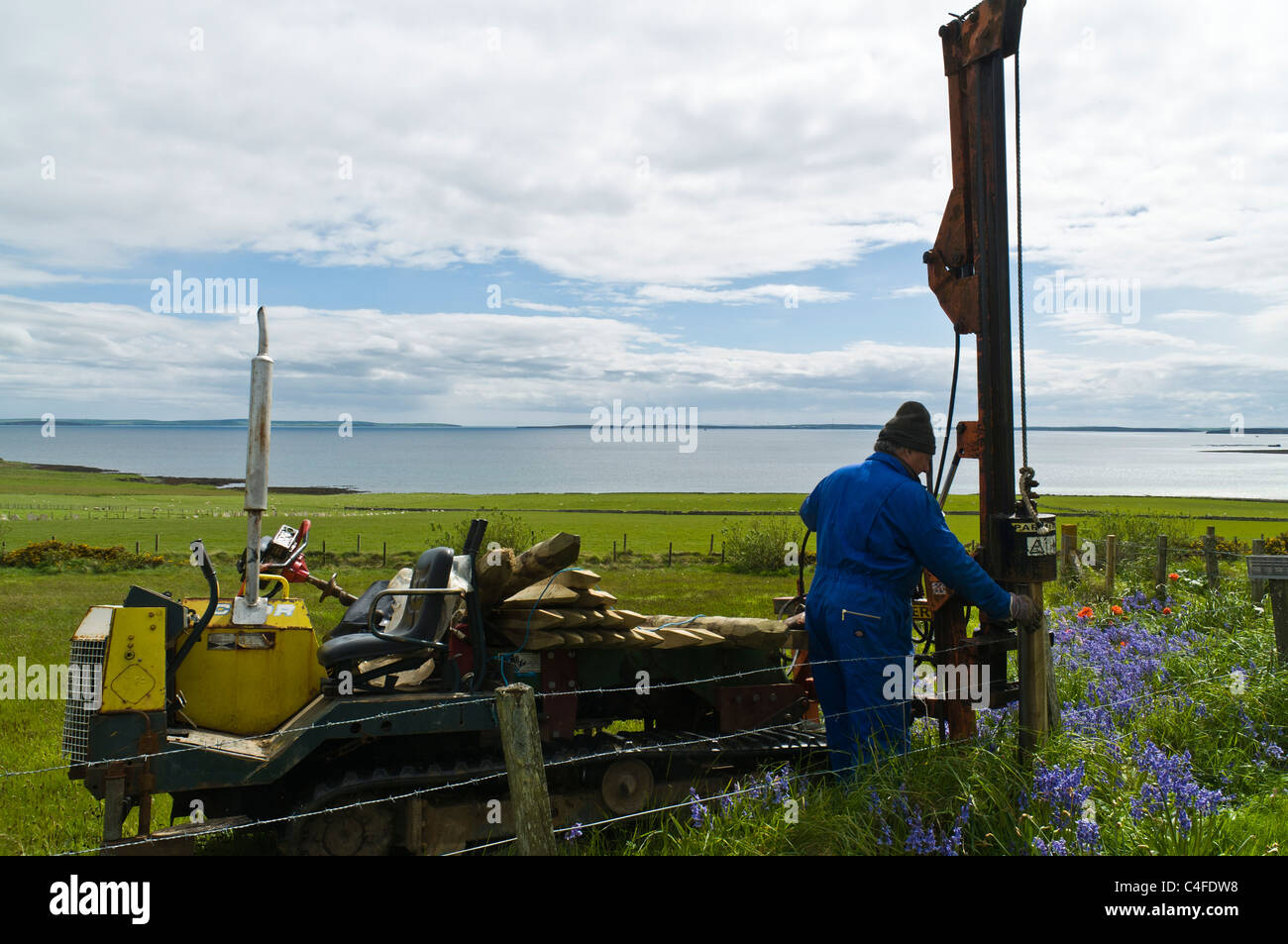 stock photo dh farming orkney low impact tracked fence post driver hydraulic post drive fencing post