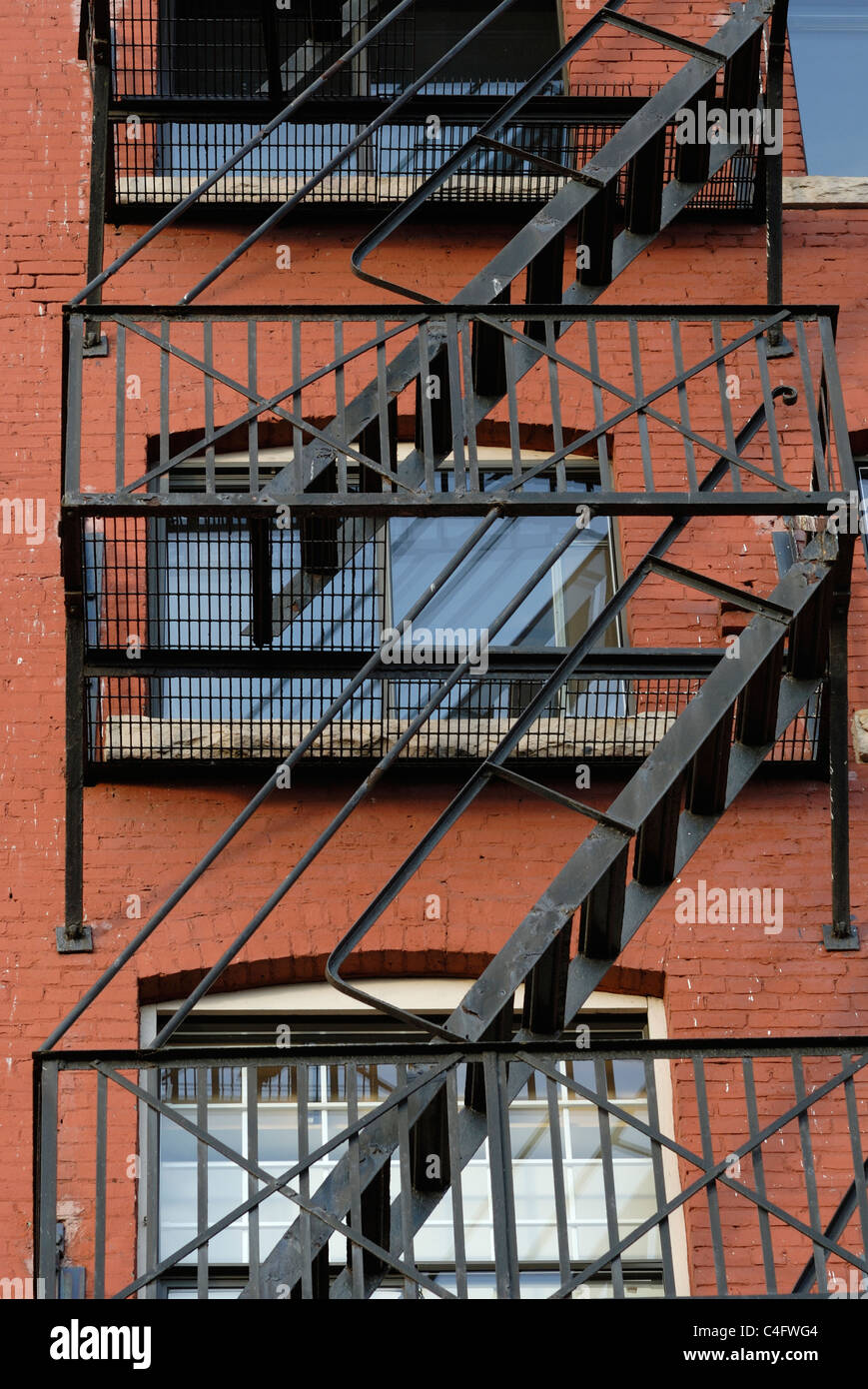 Close Up Of Metal Fire Escape Attached To A Old Red Brick Building
