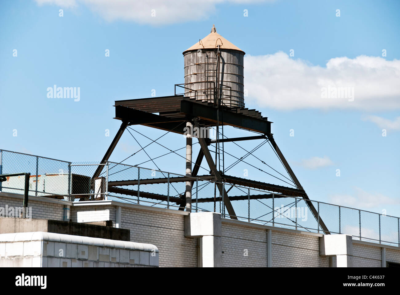 Steel Frame Towers : Typical new york city rooftop wood water tower on steel