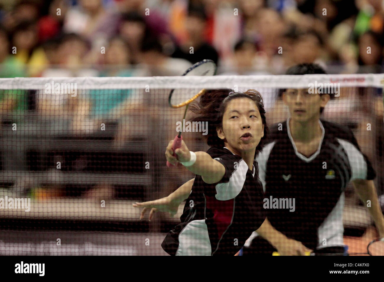 Cheng Wen Hsing and Chen Hung Ling of Chinese Taipei in action