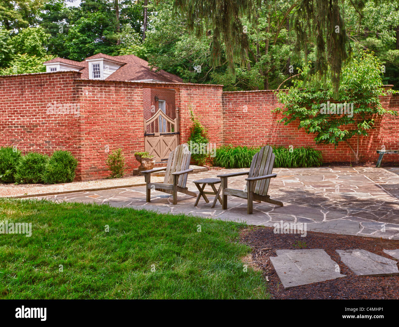 wooden cape cod style chairs on crazy paving patio in front of