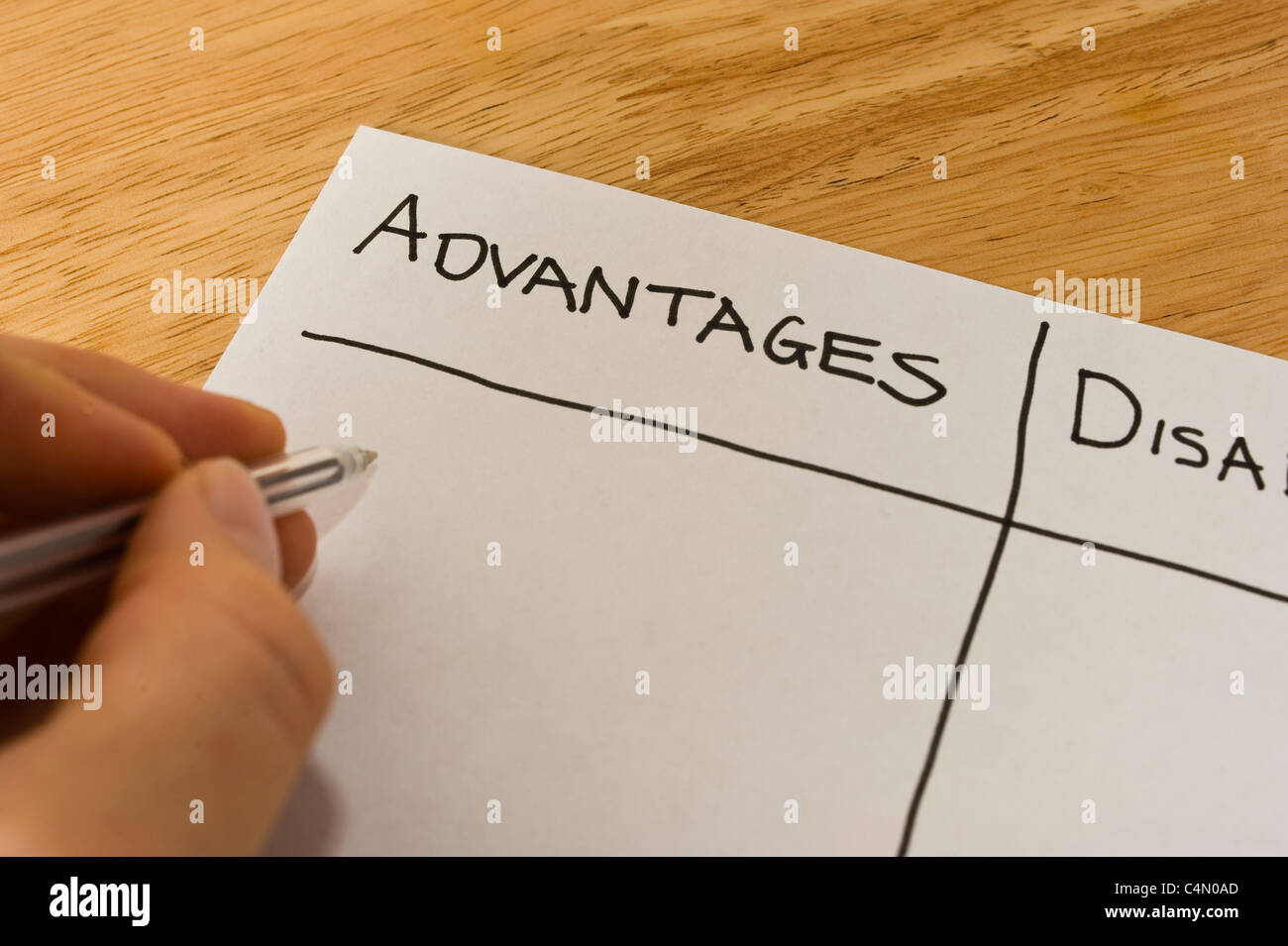 business man writing a list weighing up the advantages and stock business man writing a list weighing up the advantages and disadvantages of a decision stock