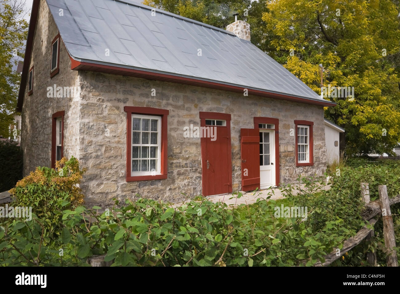 Exterior Of 19th Century Fieldstone Cottage Style Home In Autumn, Quebec,  Canada