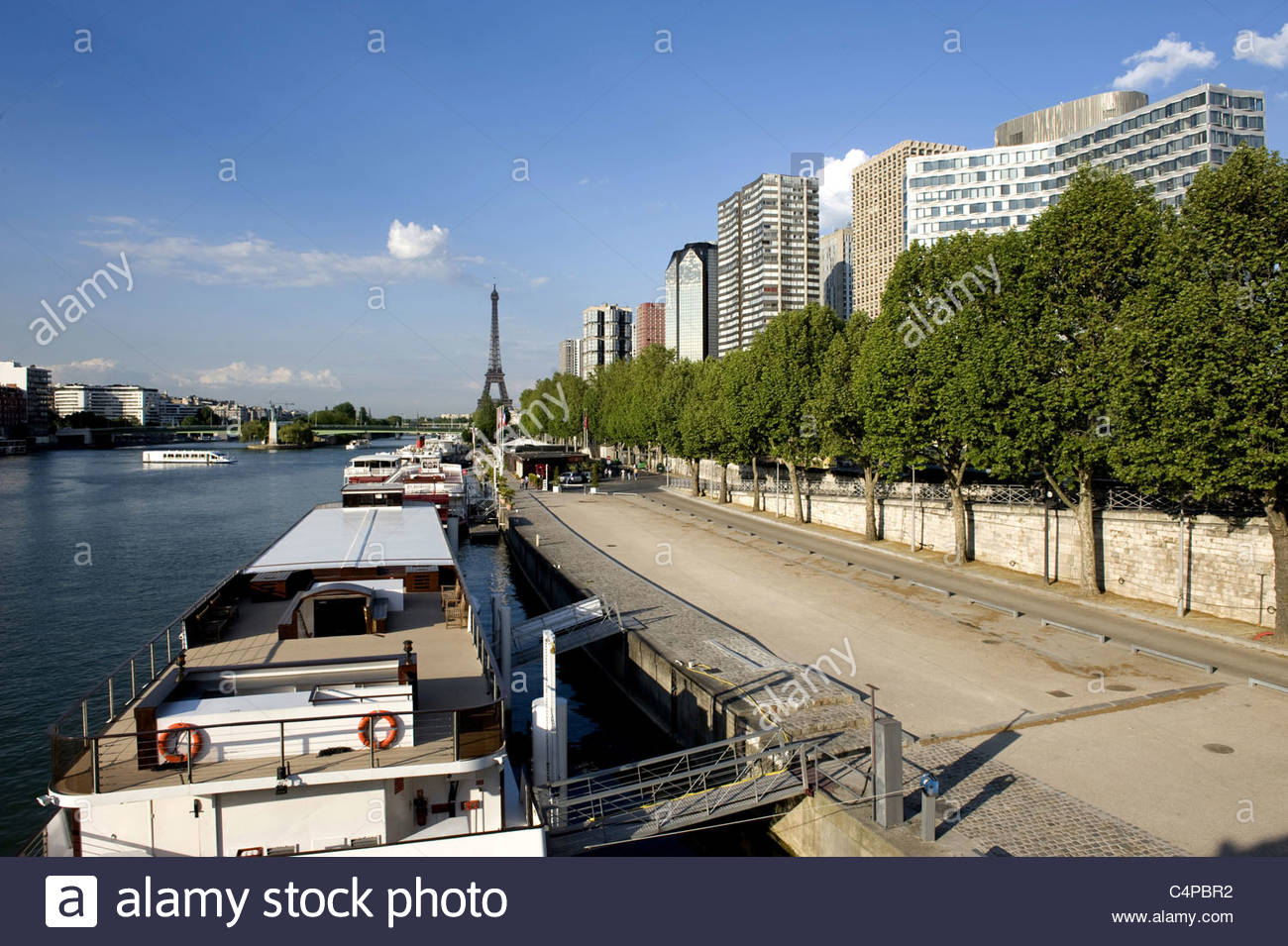 france paris quai de grenelle and the eiffel tower in the stock photo royalty free image. Black Bedroom Furniture Sets. Home Design Ideas