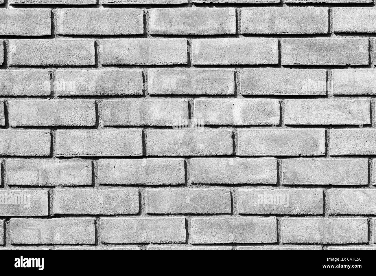 Plain wood table with hipster brick wall background stock photo - A Monochrome Black And White Close Up Photo Of A Plain Brick Wall Made Of