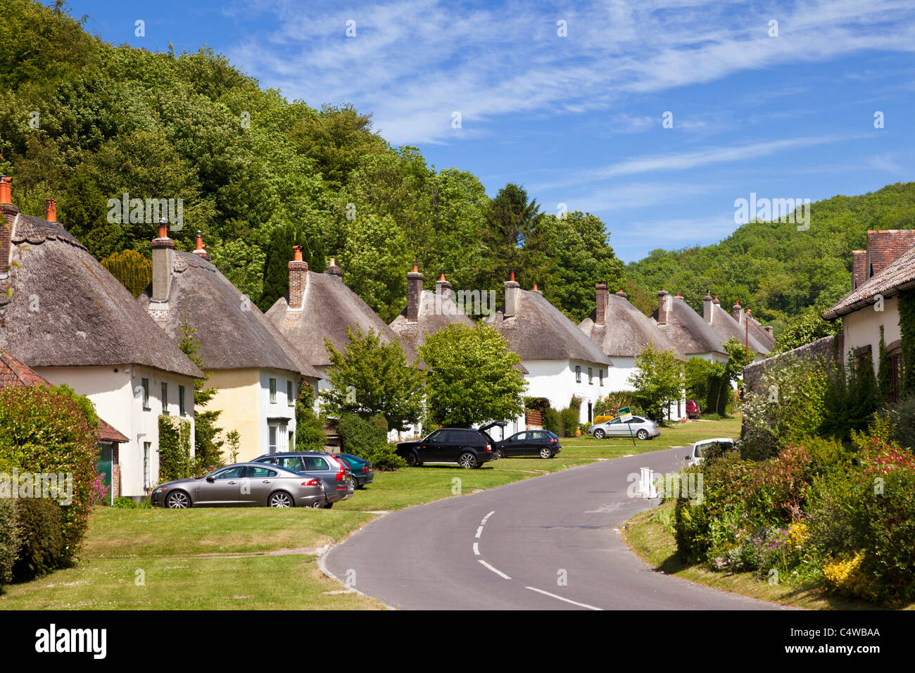 Beautiful old village uk milton abbas village in dorset england uk with traditional english thatched houses lining the street
