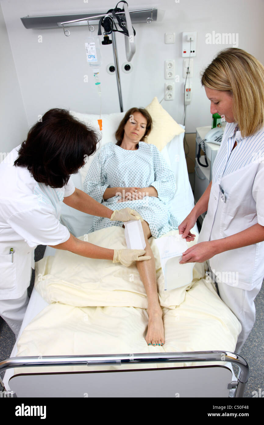 Hospital Nurses Changing A Bandage Of A Patient In A