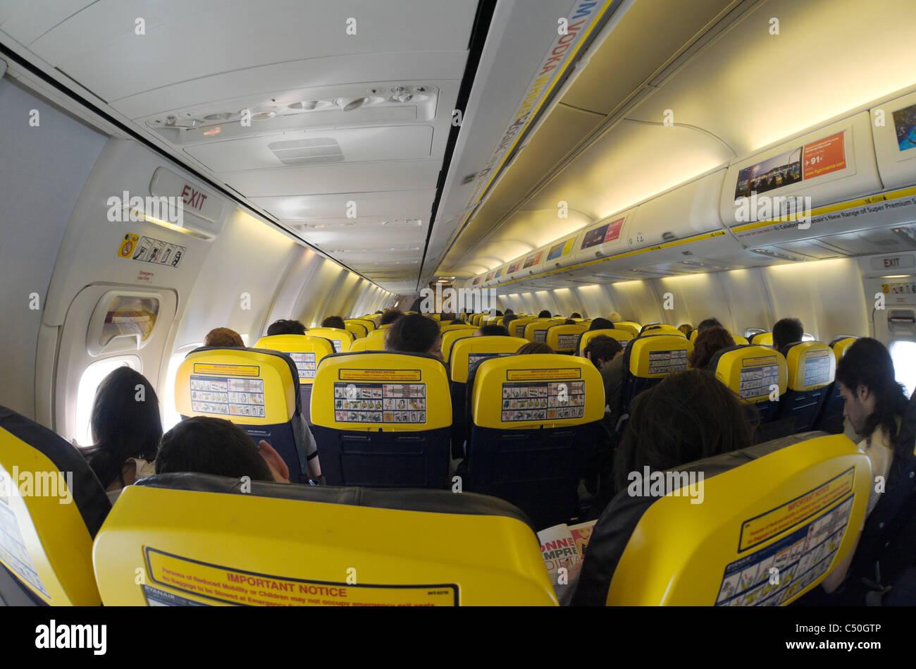Boeing 737 800 aircraft inside image - Fisheye View Of Ryanair Boeing 737 800 Interior With Passengers Shallow Dof