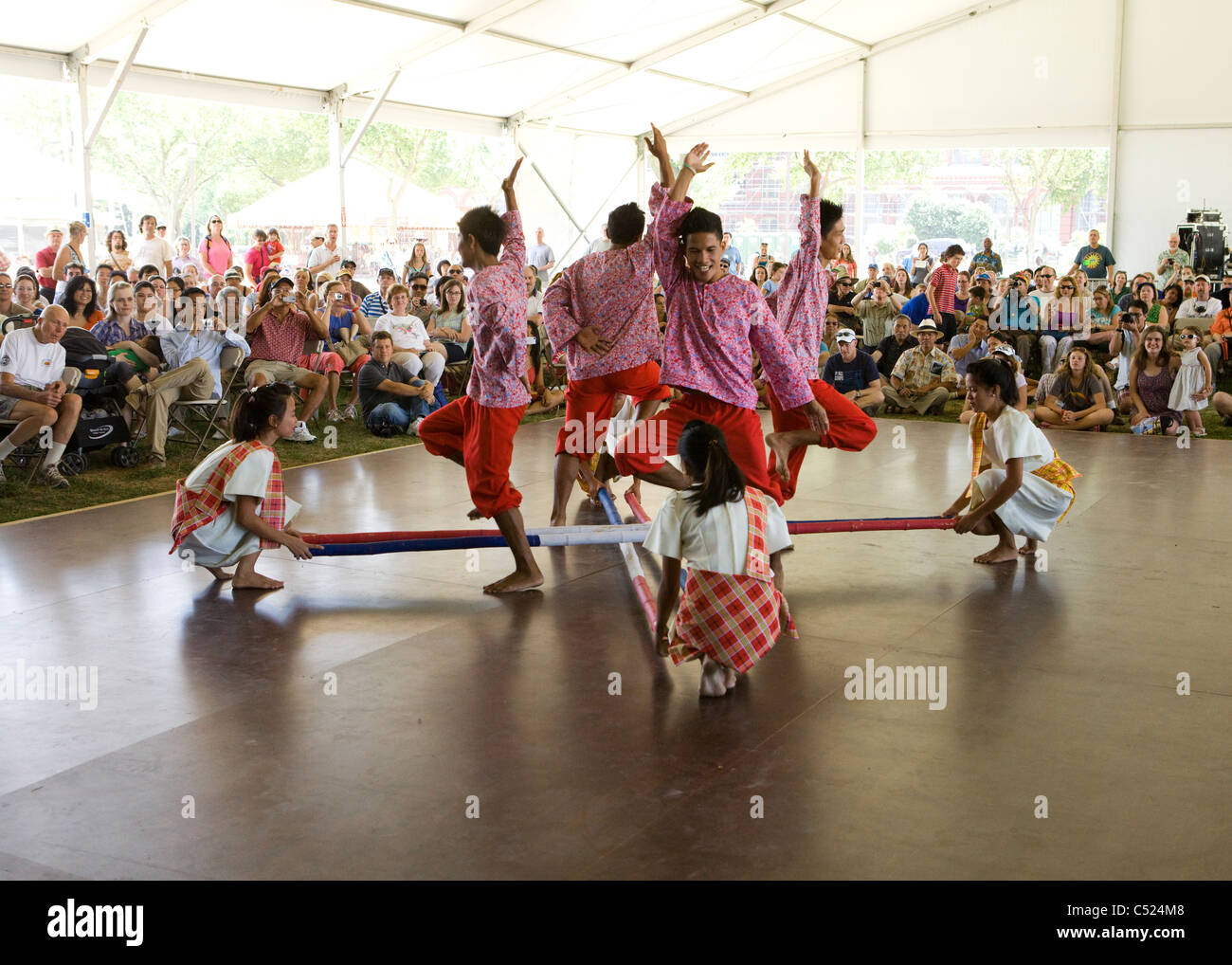 tinikling dance Tinikling is a traditional philippine folk dance which originated during the spanish colonial era the dance involves two people beating, tapping, and sliding bamboo poles on the ground and.