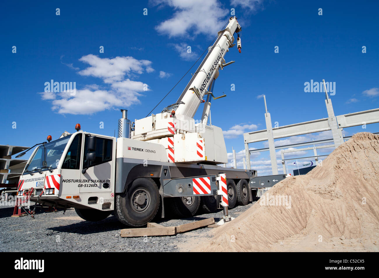 terex demag ac road mobile crane truck at site stock photo