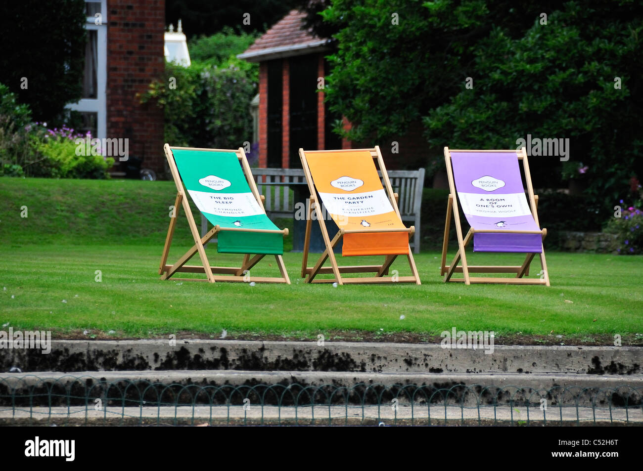 Deck Chairs With Classic Penguin Book Cover Designs On A Bankside Of  Private House In Henley OnThames, Oxfordshire, UK