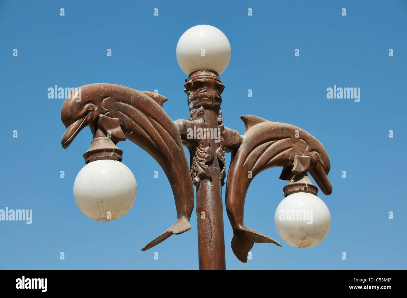 Outdoor Lighting With Decorative Dolphins And Round Globe Light ...
