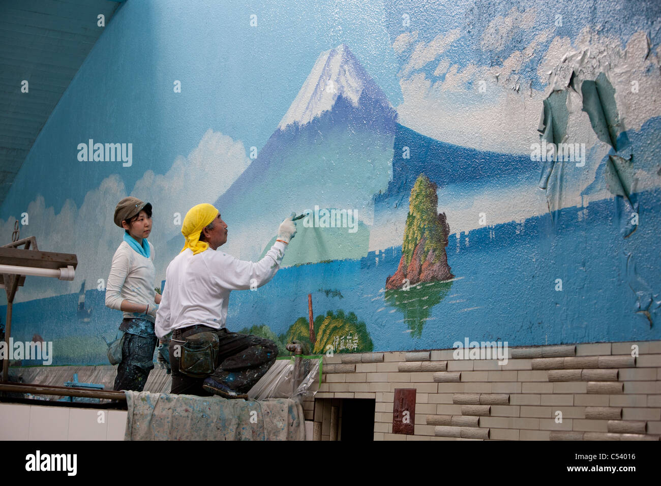 Repainting Mt Fuji Mural On The Wall Of Sento Bath House, In Tokyo, Japan. Part 42