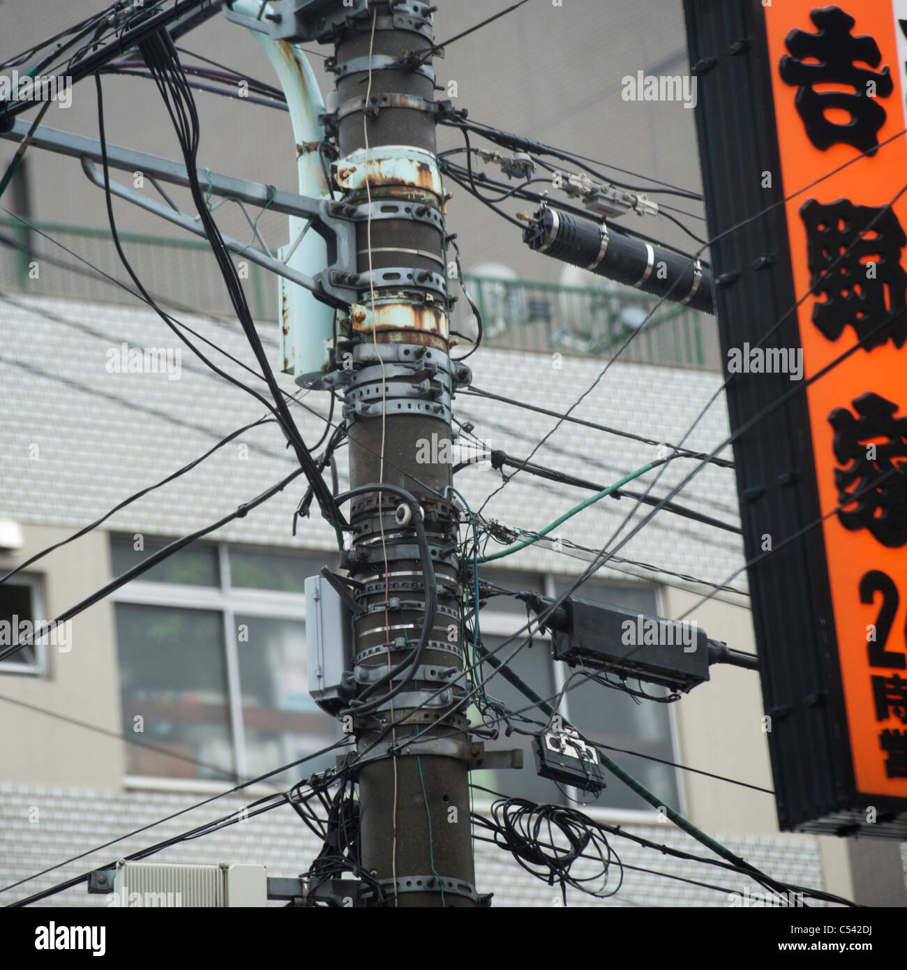 Light Pole Japan: Low Angle View Of An Electric Pole, Tokyo, Japan Stock