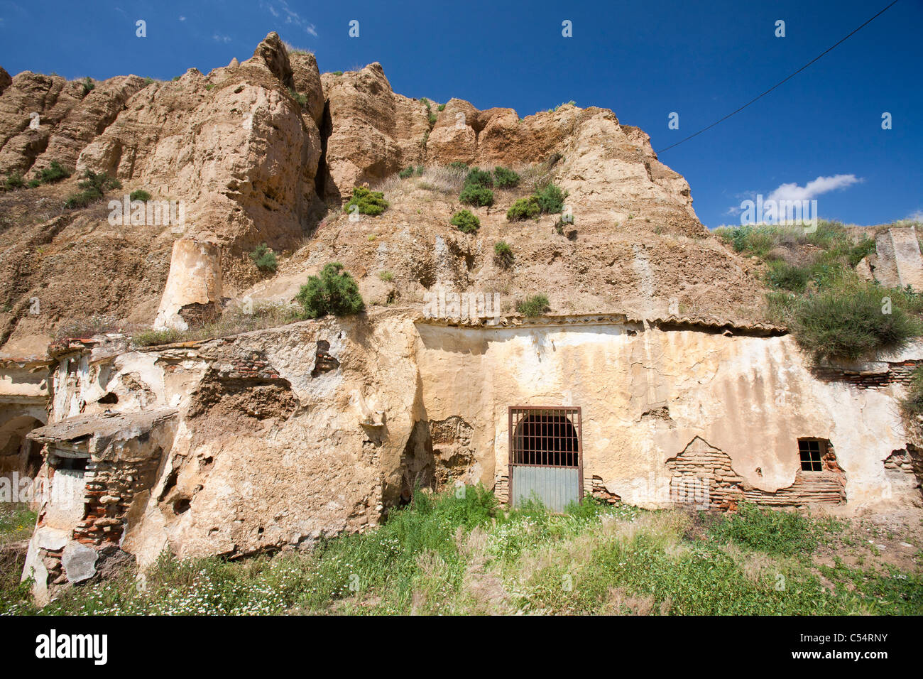 underground houses. Old Cave houses in Guadix  Andalucia Spain Up to 10 000 people still live cool underground dug out of the rock