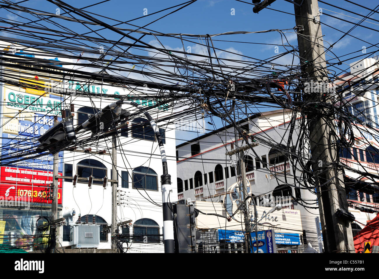 Telegraph poles and dangerous tangled mass of electricity wires ...