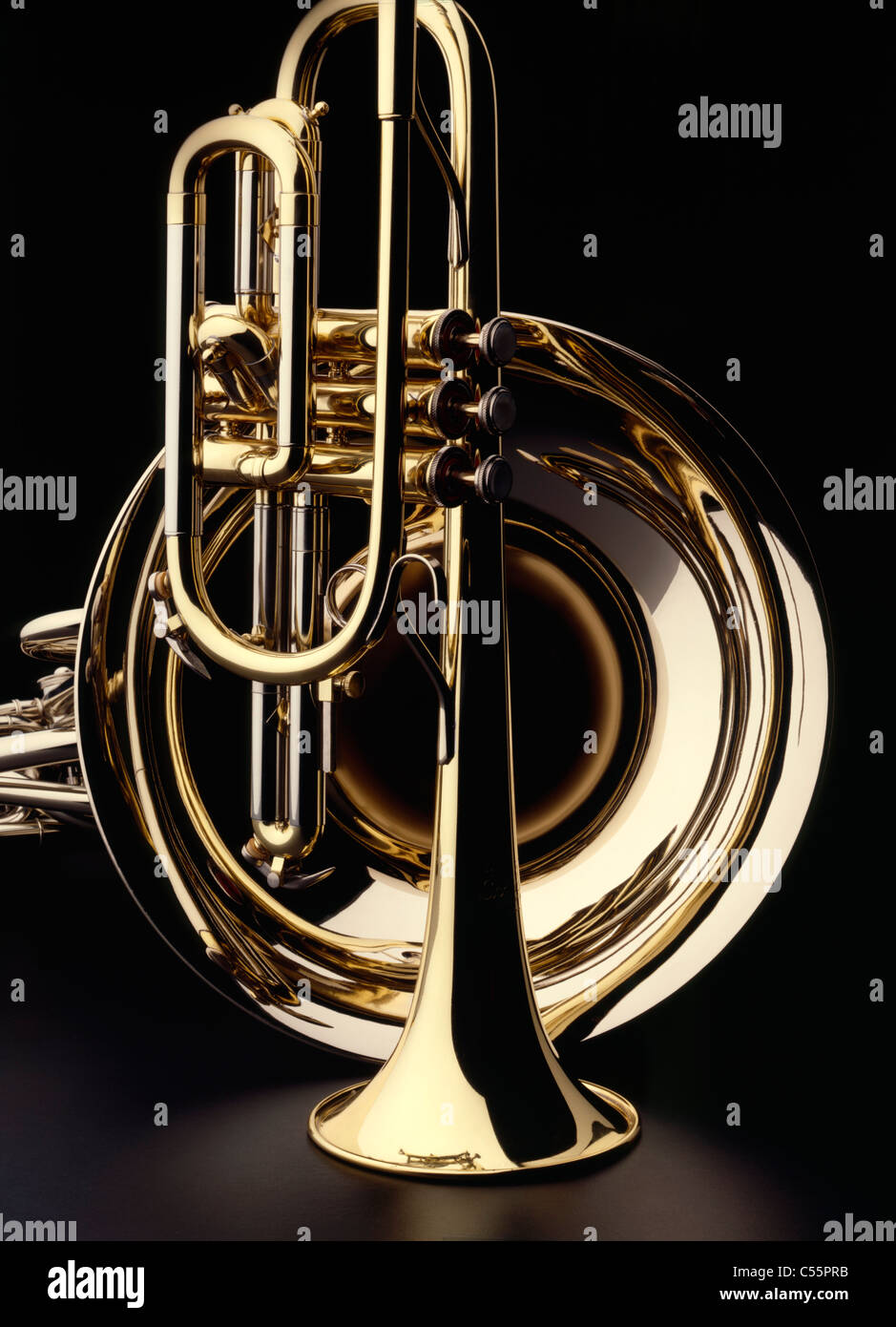 Brass trumpet and french horn on black background, studio ...