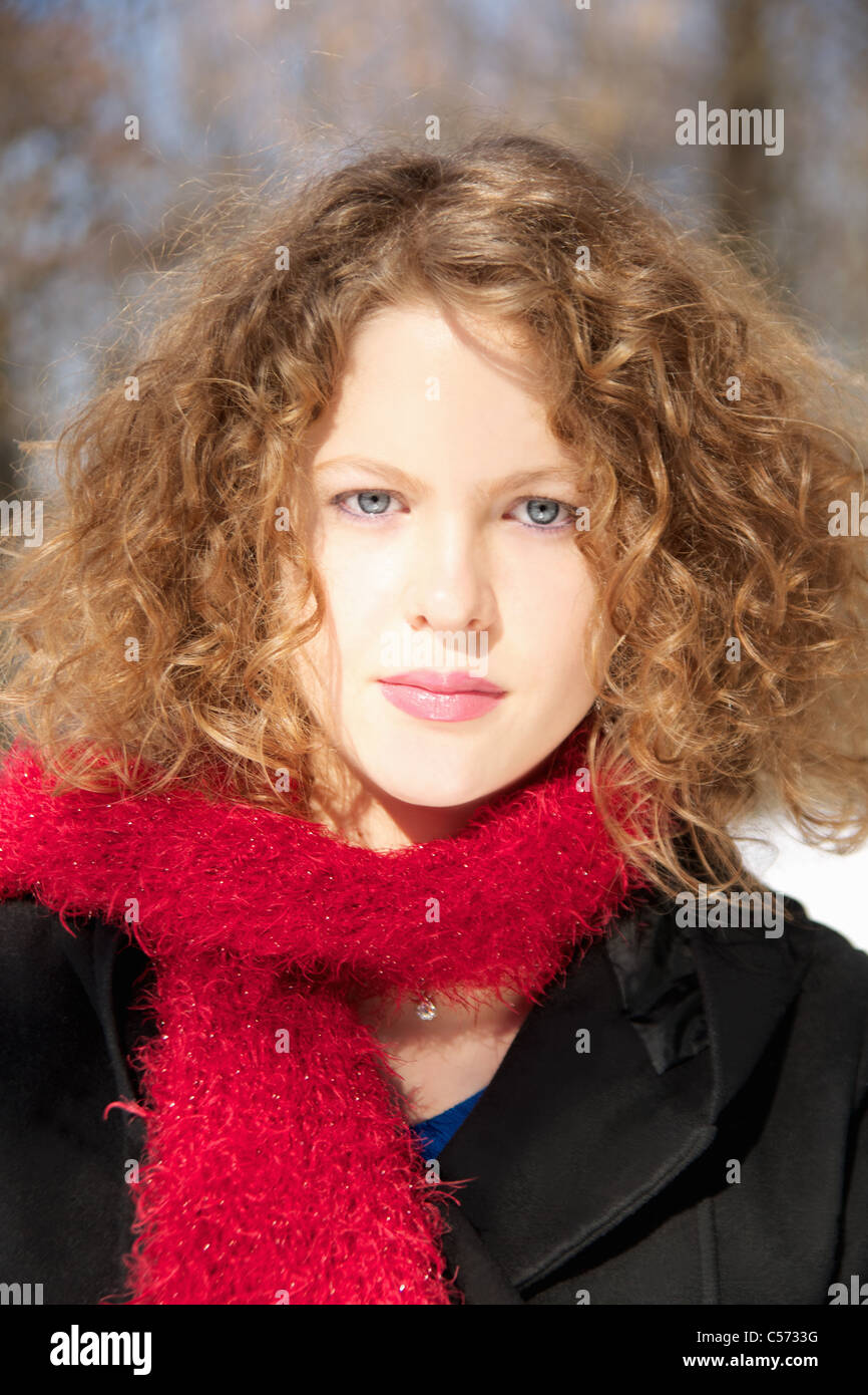 Girl wearing fuzzy scarf outdoors Stock Photo, Royalty Free Image ...