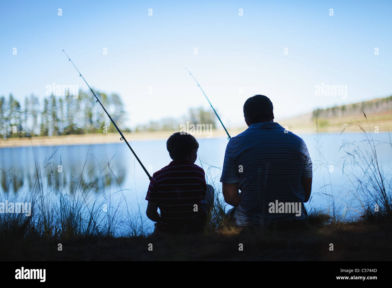 Father fishing with son in lake stock photo royalty free for Father son fishing