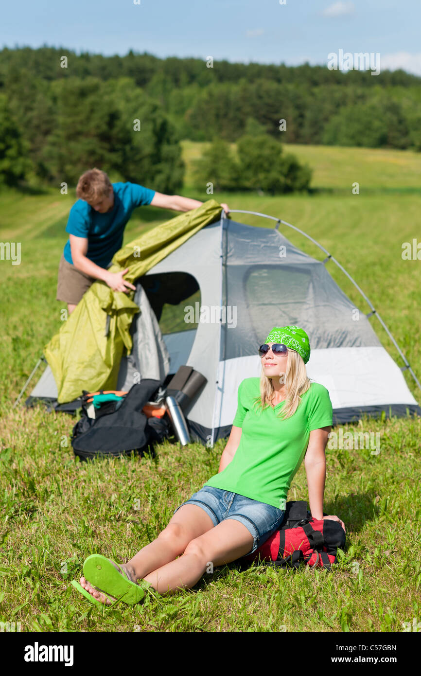 Young c&ing couple build-up tent in summer meadows countryside & Young camping couple build-up tent in summer meadows countryside ...