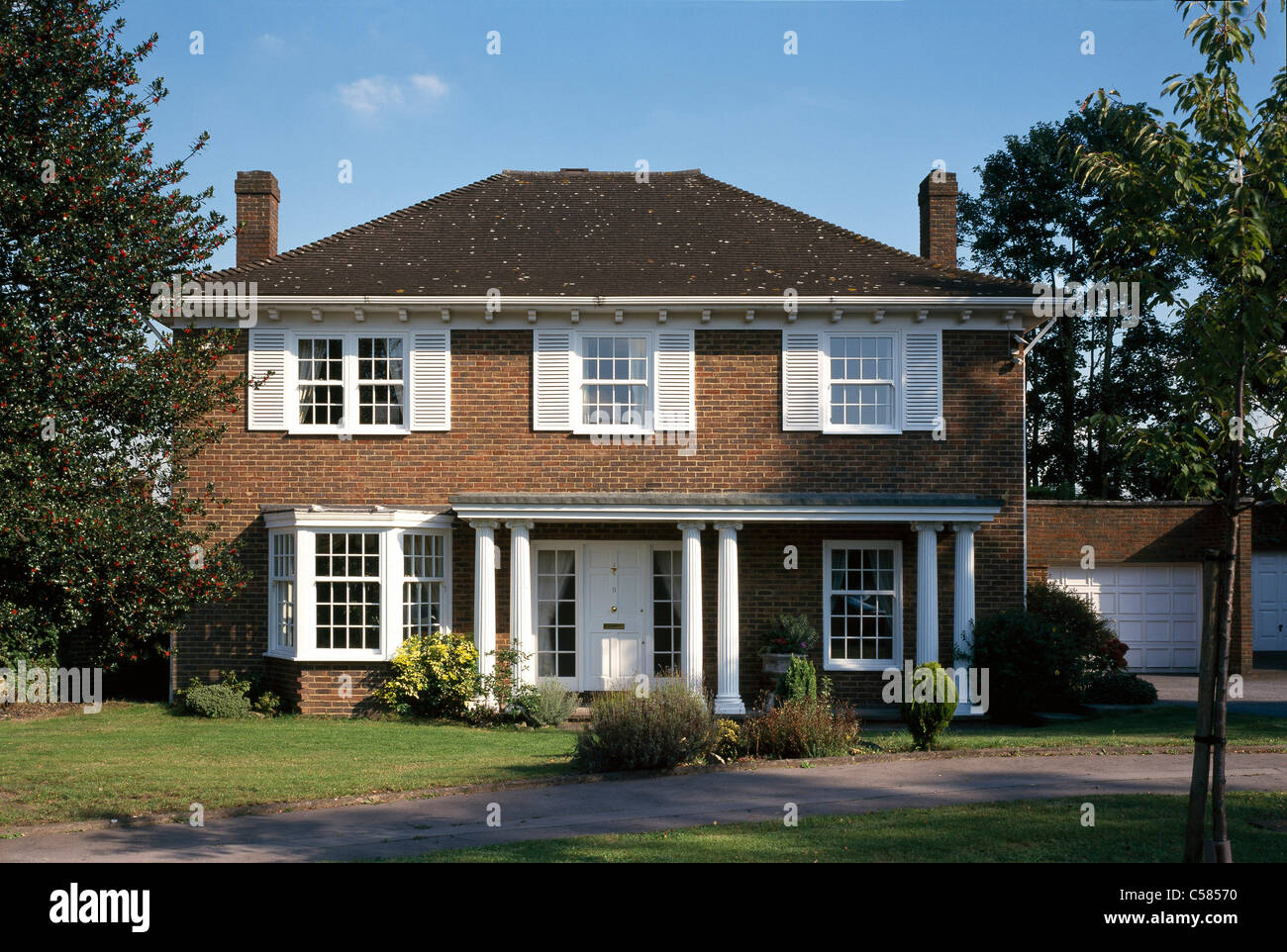 Detached House With Portico Columns And Double Garage