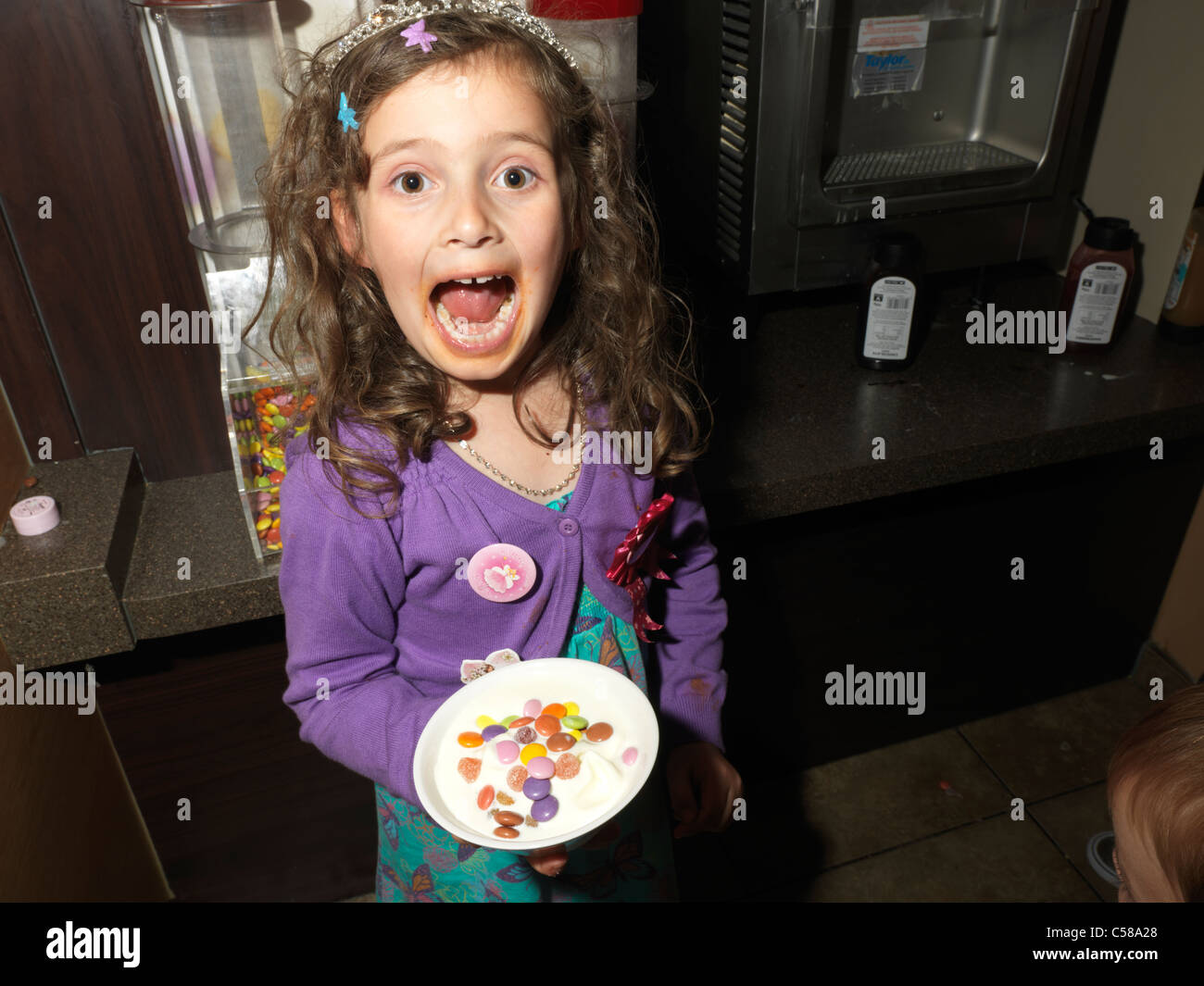 Childrens Birthday Party In Pizza Hut Girl Holding Ice Cream In A - Childrens birthday parties pizza hut