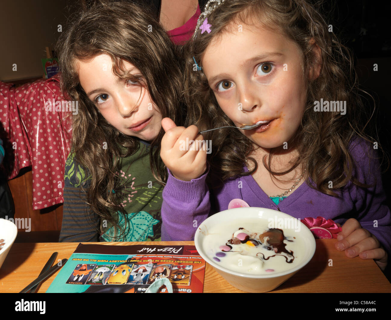 Childrens Birthday Party In Pizza Hut Girl Eating Ice Cream Stock - Childrens birthday parties pizza hut