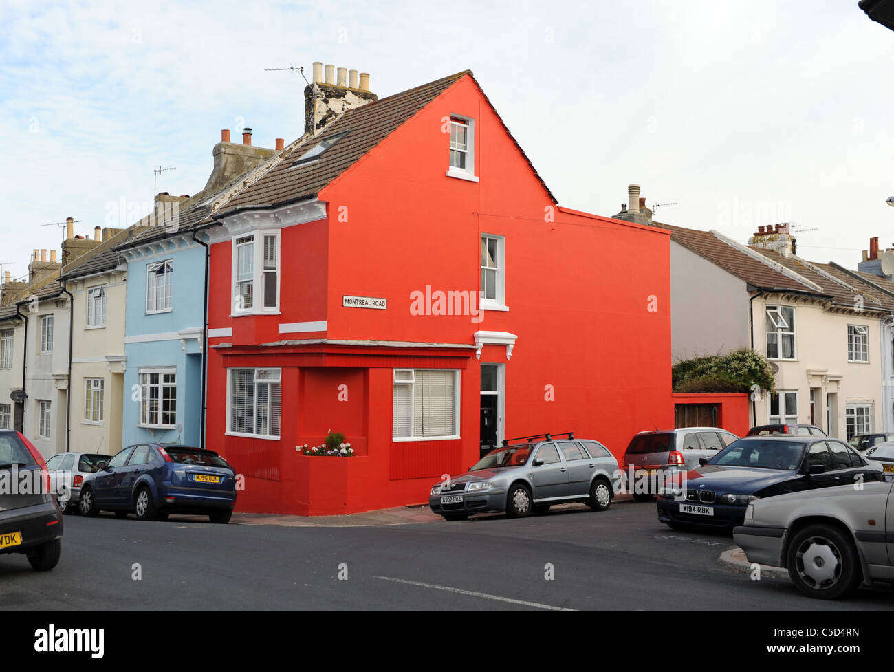 Bright Red Painted House In The Hanover Area Of Brighton Sussex UK