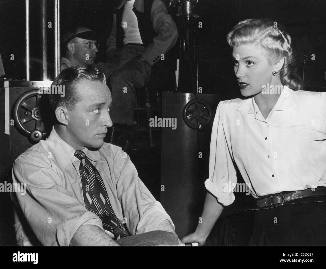 Bing crosby and joan caulfield on set of welcome stranger in 1947 stock image
