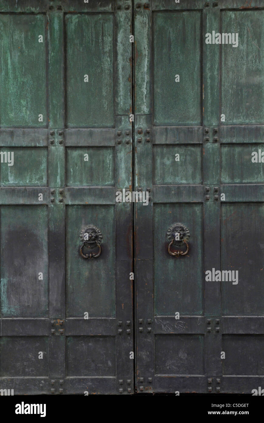 Background Of Closed Ancient Large Metal Door Stock Photo