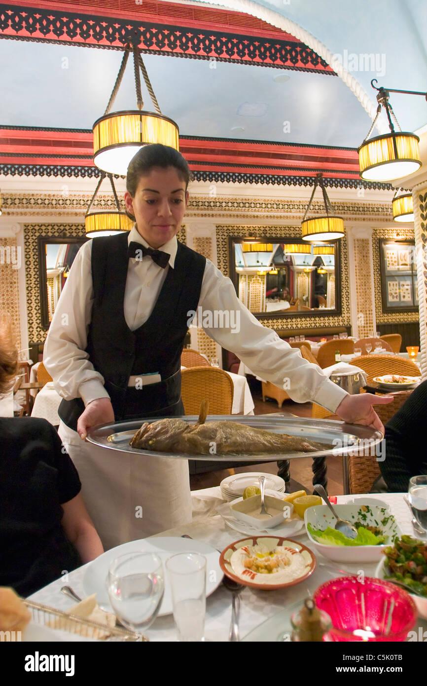 Waitress serving fish in restaurant, Beirut, Lebanon Stock ...