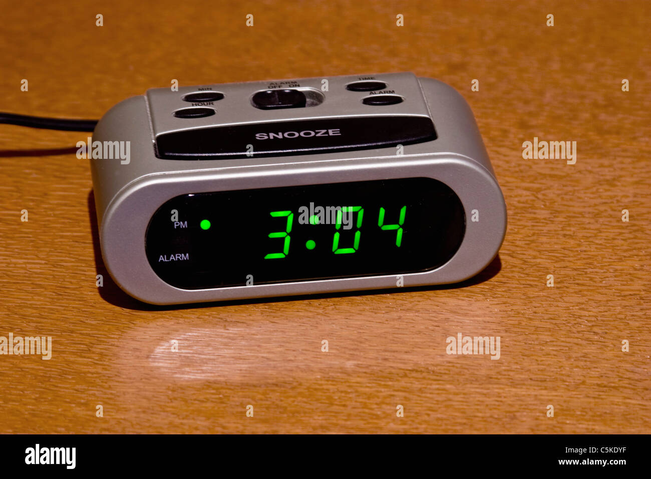 Digital alarm clock on nightstand Stock Royalty Free Image